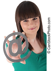 Teenager holding the at symbol