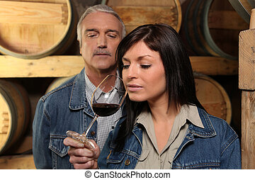 Woman tasting wine in cellar