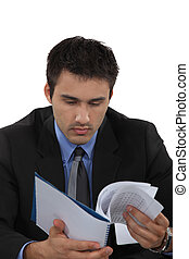 A businessman reading notes.
