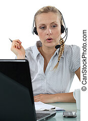 Woman having a hands-free telephone conversation