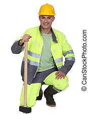 portrait of bricklayer all smiles with safety outfit