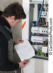 Electrician with sketch of electrical panel