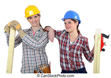 Female builders with timber