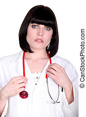 Worried doctor with a stethoscope around her neck
