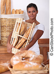 Young woman working in a bakery