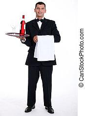 Waiter holding tray with wine bottle