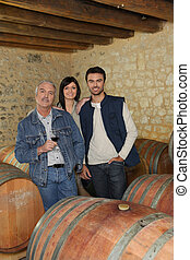 People in a wine cellar