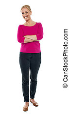 Full length portrait of happy aged woman posing with arms...