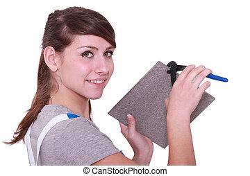 Woman cutting a tile