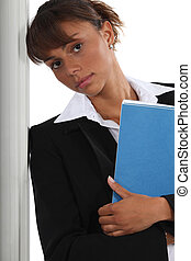 Serious businesswoman with file