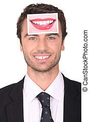 Businessman with a photograph of lips on his forehead