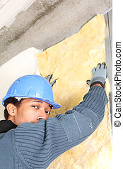 Man putting up wall insulation