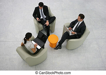 Businesspeople sitting in an atrium