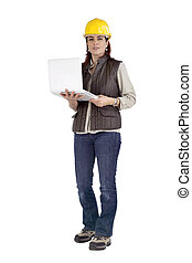 Female construction working holding a laptop