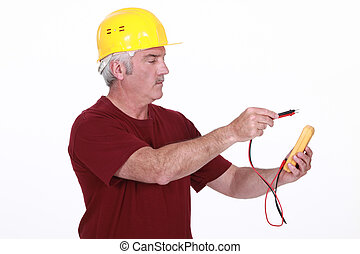 Electrician using multimeter