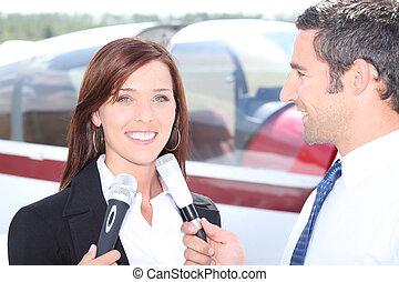 A journalist interviewing woman