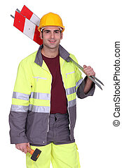 road worker holding road signs