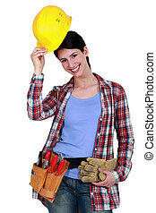 Tradeswoman putting on her hard hat