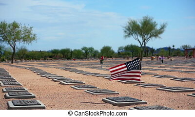 American Patriots Lost - American flag flying at a grave...