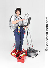 Tradeswoman pointing to her laptop