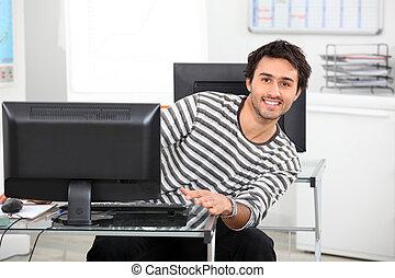 Young man at a computer