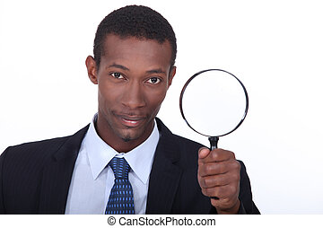 portrait of a man with magnifying glass