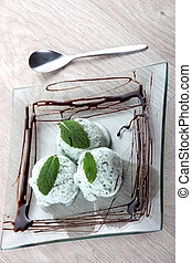 Mint ice cream on square dish