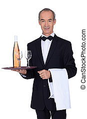 Senior waiter holding tray