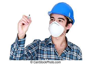 Worker wearing a face mask and holding a felt-tip pen