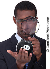 Man looking through a magnifying glass