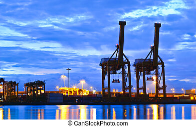 Crane and container - Containers and cranes at the port at...
