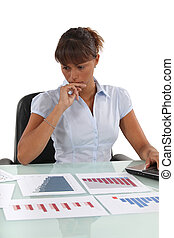 Concerned office worker working with bar charts