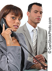 Business couple making important call