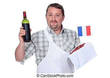 Frenchman with a bottle of red and a raw steak