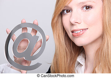 Girl holding metallic at symbol