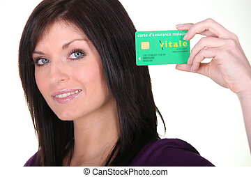 Woman showing French Carte Vitale