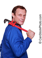 Worker with a pipe wrench