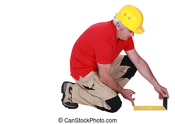 Middle-aged carpenter using set-square