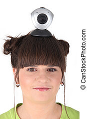 Girl with camera placed on her head