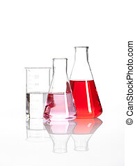 Laboratory flasks with a red liquid