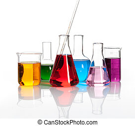 Various laboratory flasks with a colored liqiuds - Various...