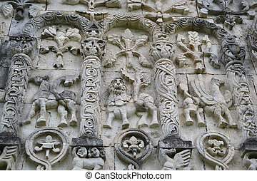 The bas-relief on the wall of a building