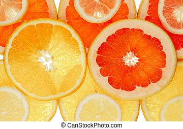 Fruity background set of whole orange, grapefruit and lemon disks