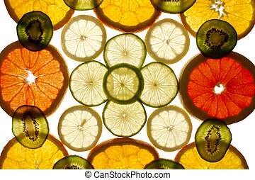 Colorful background of different fruit slices