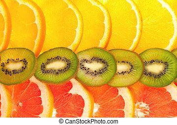 Fruity background set of whole orange, grapefruit and kiwi disks