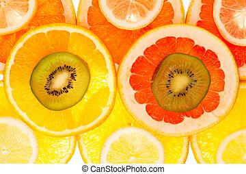 Background of kiwi, grapefruit, orange and lemon disks
