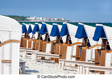 Many wicker beach chairs in a row on the german baltic sea...