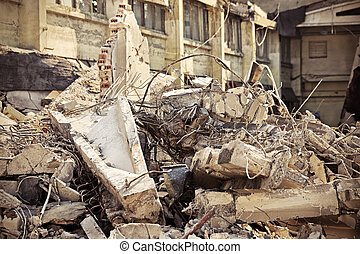 Rubble - A picture of o heap of rubble and a demolished...
