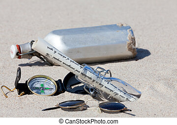 Treasure hunt on an island with compass and bottle message