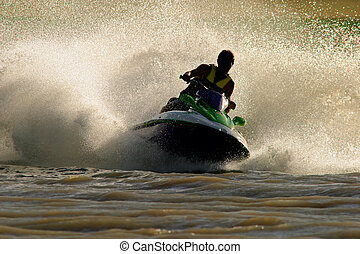Jet ski action - Backlit jet ski with water spray